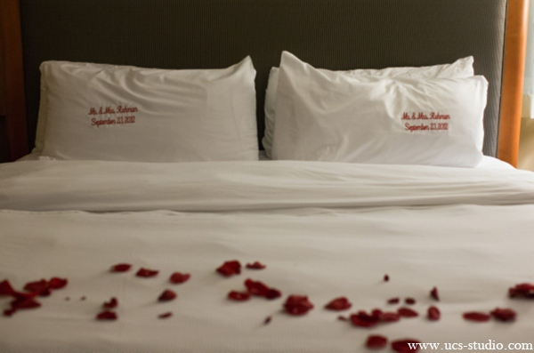 Indian-wedding-couples-suits-rose-petals-bed