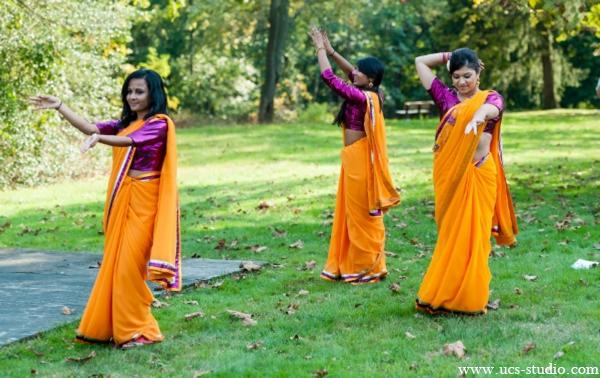 Indian-wedding-gaye-holud-tradtions-outside-colorful-lengha