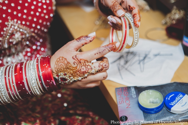 Indian wedding getting ready bride bangles mehndi