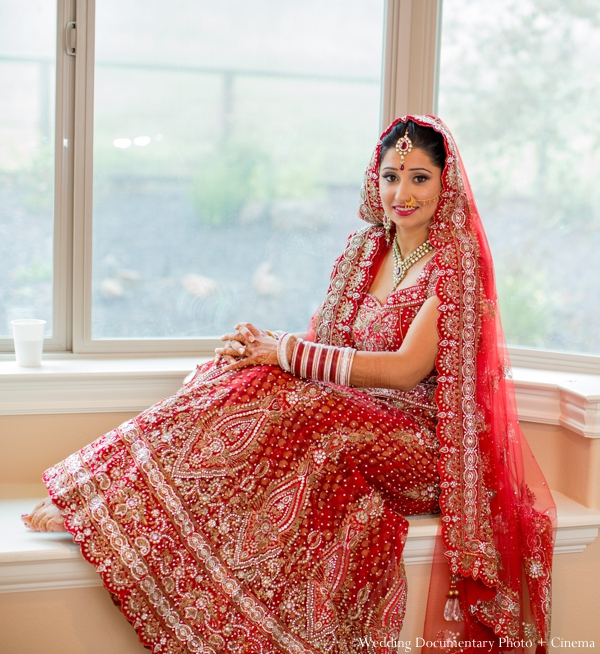 A Portrait Of The Indian Bride In Her Traditional Ceremony Lengha Red And Gold
