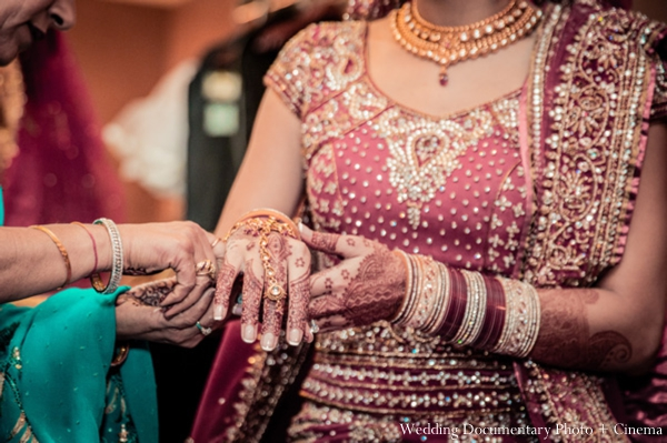 Indian-wedding-bride-get-dressed-for-ceremony