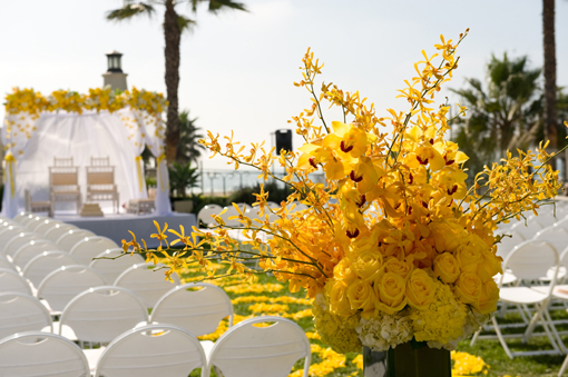 Outdoor indian wedding yellow decor 1