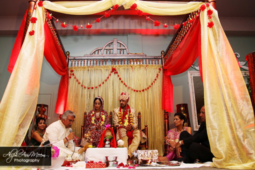 Indian bride and groom, yellow and red mandap
