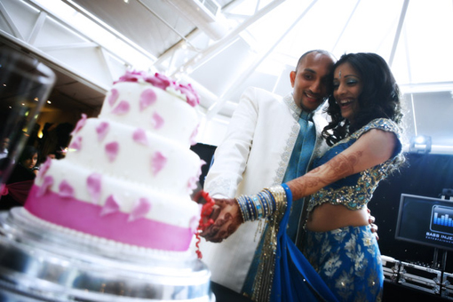 Indian bride and groom, pink wedding cake