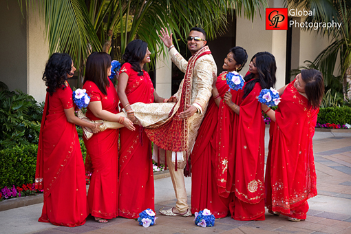 Indian wedding, red bridesmaid saris