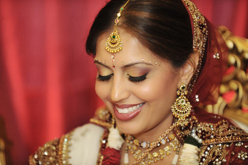 Indian-bride-gold-tikka-red-lengha