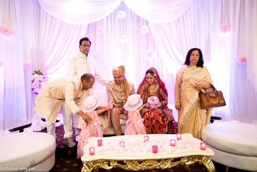 Indian-wedding-reception-pink-kissing-balls-white-stage-1