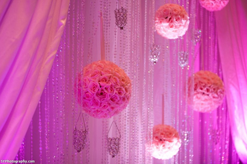 Indian-wedding-reception-pink-kissing-balls-white-stage-2