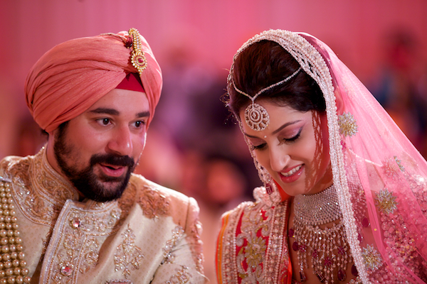indian bride and groom at Indian wedding with pink theme