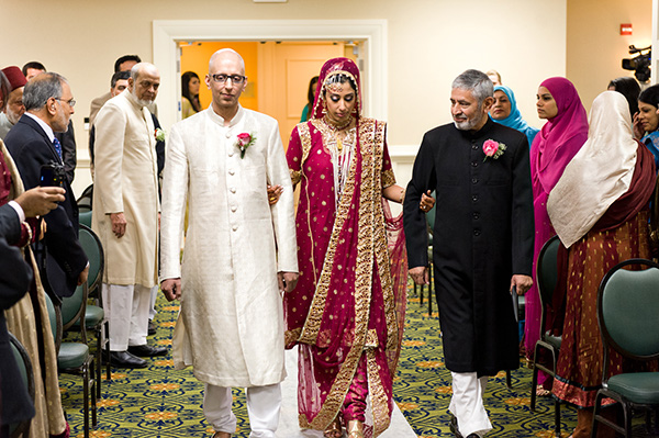 An Indian bride walks down the aisle at her traditional Muslim Indian wedding.