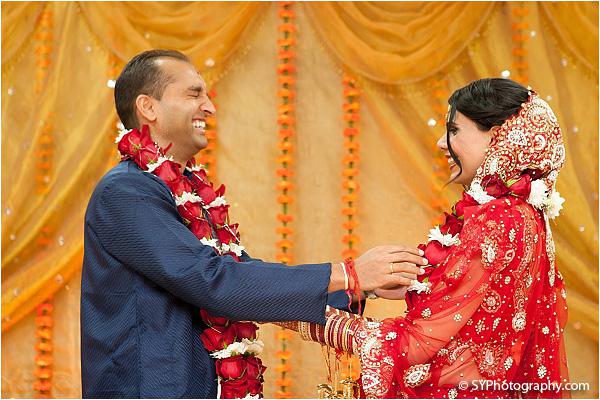 An Indian bride and groom share laughter at this beautiful Indian wedding.