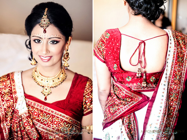 A beautiful Indian bride wears a traditional bridal outfit.
