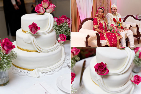 An Indian wedding cake is decorated in a simple, modern style with pink roses.
