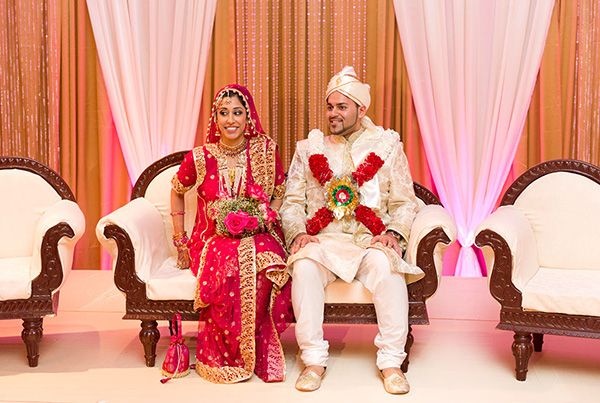 An Indian bride and groom at their Indian wedding reception.