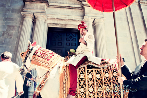 An Indian groom arrives to his modern Indian wedding.