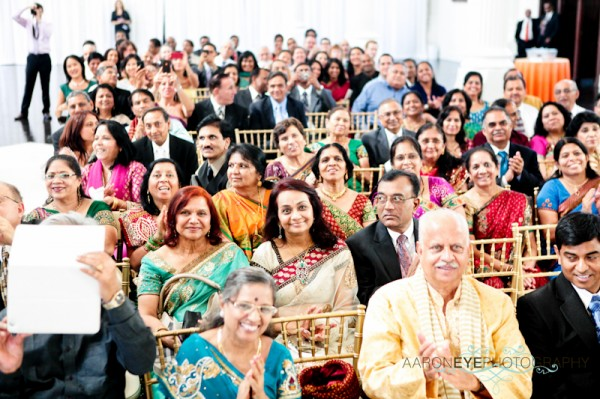 Friends and family at a modern Indian wedding ceremony.