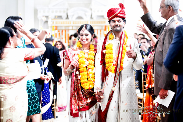 An Indian bride and groom as they leave their Indian wedding ceremony.