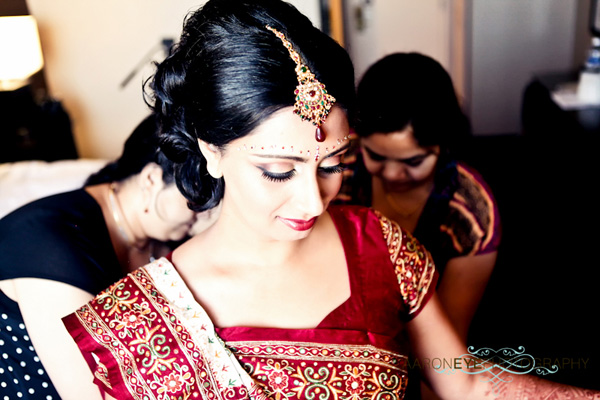 An Indian bride prepares for a modern Indian wedding.