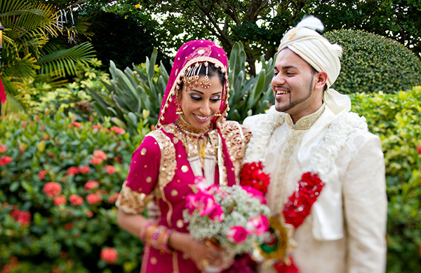 Indian bride and groom take wedding portraits at their Muslim Indian wedding.
