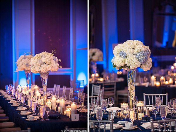 Tall floral centerpieces fill this Indian wedding reception.
