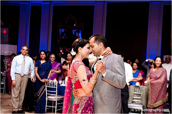 An Indian bride and groom slow dance at the Indian wedding reception.