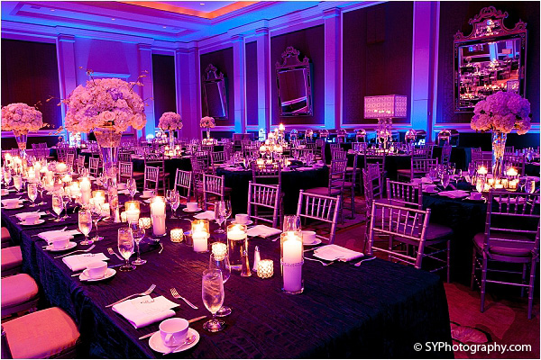 Purple and blue lights light up this Indian wedding venue.