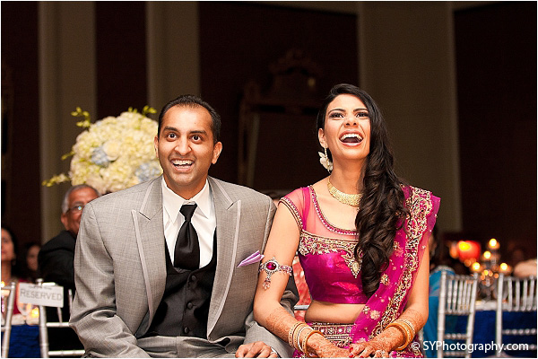 An Indian bride and groom enjoy their Indian wedding reception in Fairfax, Virginia.