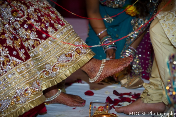 Bridal mehndi on feet with Indian bridal anklets.