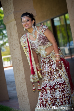 Indian wedding photography captures traditional indian bride.