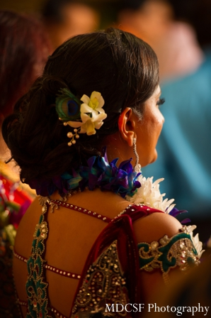 Indian bridal hairstyles with flowers for a peacock theme indian wedding.