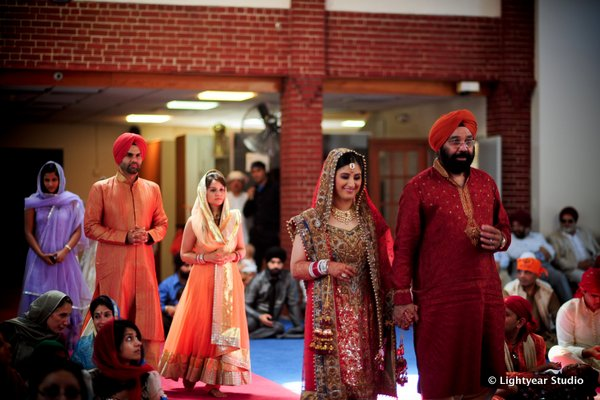 An Indian bride enters her Sikh wedding.