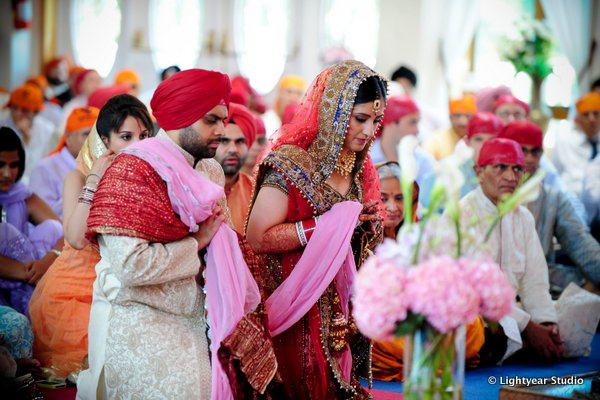 An Indian bride and groom at their Sikh wedding.