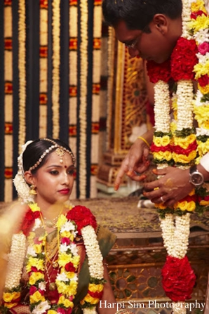 Indian wedding ceremony with a indian bride in a traditional south indian sari.