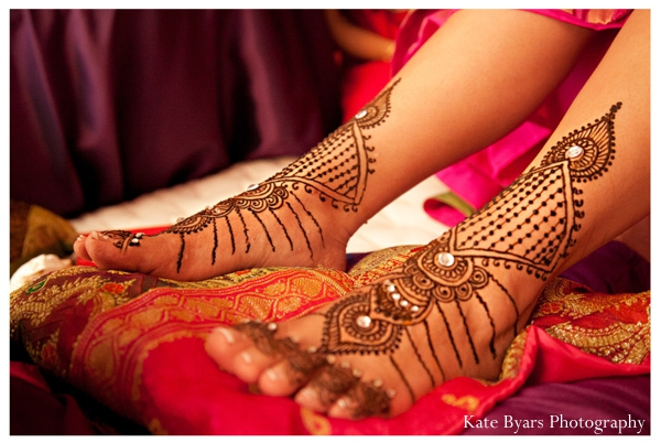 Bridal mehndi with crystals on feet of an indian bride.