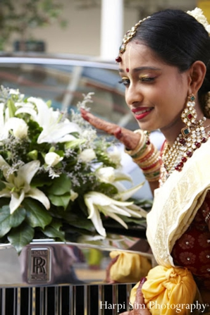 An Indian bride wears traditional indian bridal jewelry.