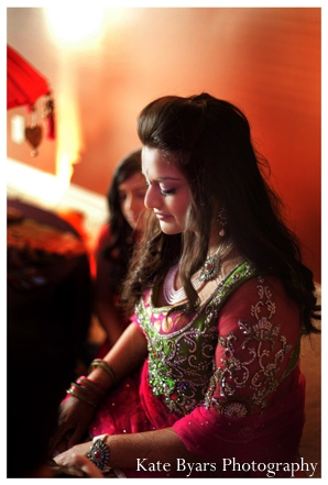 Indian bride wears pink and lime green bridal lengha at her mehndi party.