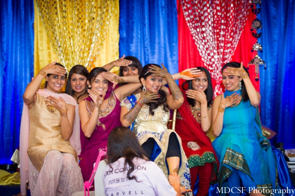 Indian bride and her friends at a mehndi party before Indian wedding.