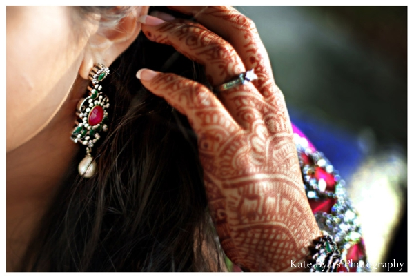 Closeup of bridal mehndi on hands and an Indian bridal jewelry set.