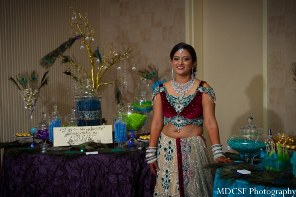 Indian bride at her peacock themed ganesh puja Indian wedding party.