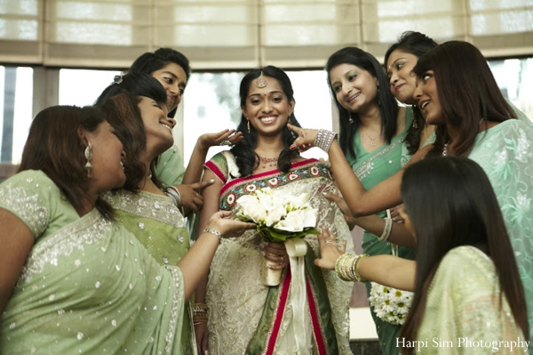 Indian bride and bridesmaids in green bridal saree fashion.