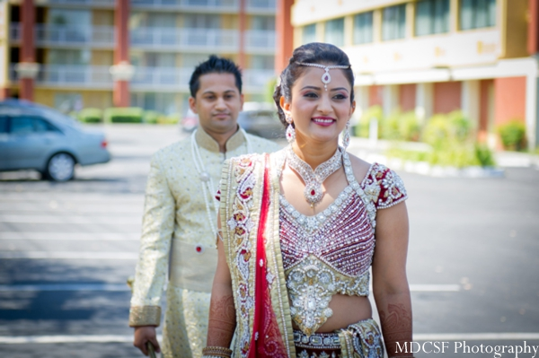 Indian wedding photography captures first look photo with indian bride and groom.