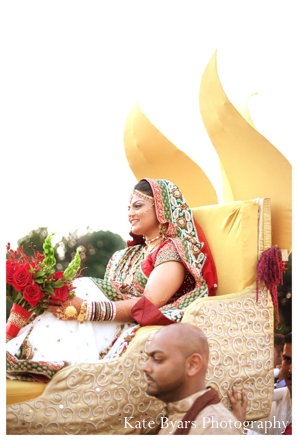 Indian bride in traditional bridal lengha arrives to her Indian wedding ceremony.