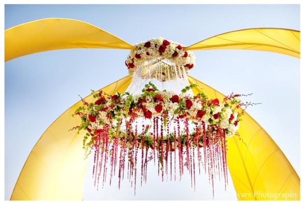 Floral centerpiece chandelier for an outdoor modern mandap.