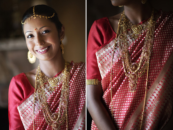 An Indian bride wears a red bridal sari and gold bridal indian jewelry.