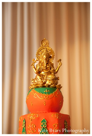 Ganesh sits on top of this indian wedding cake.