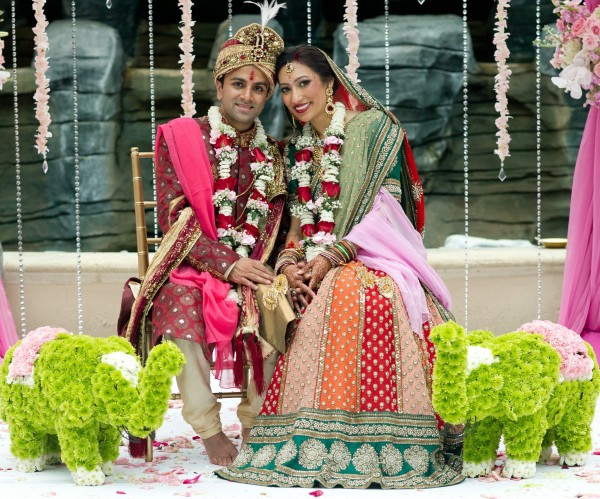 An Indian bride and groom at their modern Indian wedding ceremony.