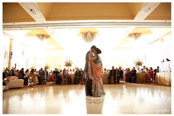 Indian bride and groom dance at a modern indian wedding reception.
