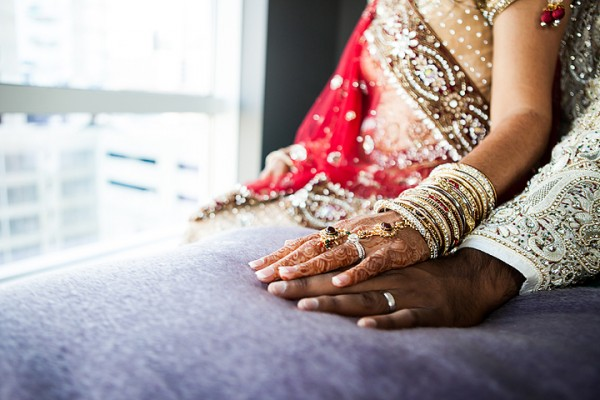 Indian wedding photography shows off an Indian bride's bridal henna and her indian bridal jewelry.