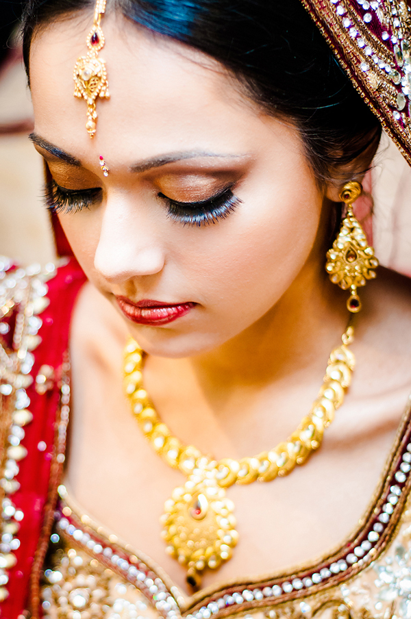 Indian bride makeup accentuates this Indian bride's eyelashes and lips.