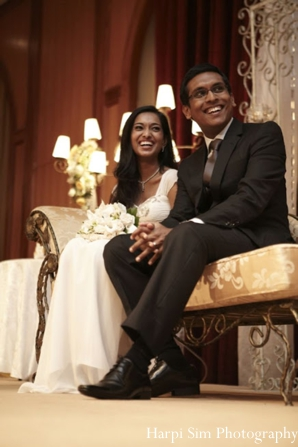 Indian bride and groom at their modern indian wedding reception.